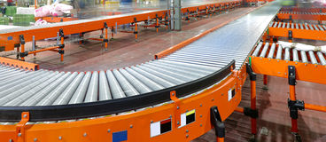 Conveying System. Conveyor System in Regional Delivery Hub Warehouse Stock Photography
