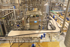 Conveyor. The interior of the brewery. The conveyor line for bottling of beer royalty free stock photos