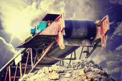 Conveyor against stormy cloudscape Royalty Free Stock Photo