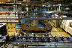 Conveyor with beer bottles  at the Heineken brewery in St. Peter Stock Photography