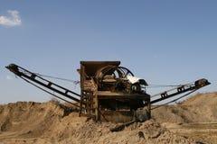 Conveyor belt. At sand mining site under clear blue sky Stock Photos