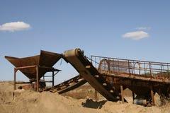 Conveyor belt. At sand mining site under clear blue sky Stock Image