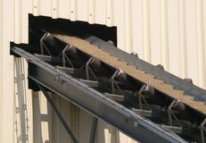 Conveyor belt. A conveyor belt transporting sand into a building of a concrete factory Royalty Free Stock Photos