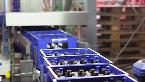 Conveyor belt of a brewery - beer bottles in production and bottling