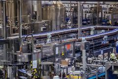 Conveyor belt of brewery production line . Beer bottles are moving on conveyor Stock Image