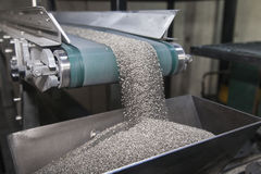 Conveyor belt. Carrying industrial powder for manufacturing Stock Images