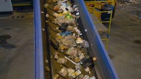 Conveyor belt carrying waste. Waste disposal plant.4K. The conveyor belt is carrying the waste trough the waste disposal plant stock video footage