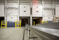 Conveyor belt in cross dock loading packages to ba Stock Photo