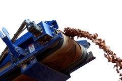 Conveyor belt on crusher. A Conveyor belt in a gravel quarry drops gravel close up shot Royalty Free Stock Photography
