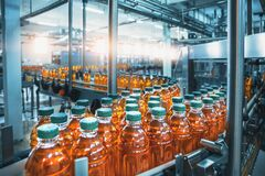 Free Conveyor Belt, Juice In Bottles, Beverage Factory Interior In Blue Color, Industrial Production Line Stock Photography - 179919222