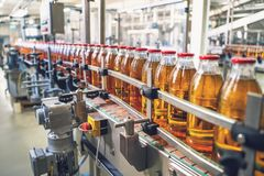 Free Conveyor Belt, Juice In Glass Bottles On Beverage Plant Or Factory Interior, Industrial Manufacturing Production Line Royalty Free Stock Photo - 161019295