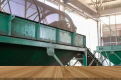 Conveyor belt for loading fertilizer. drum mold in plant factory with wood table for montage display product. Conveyor belt for loading fertilizer. drum mold in stock image