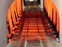 Conveyor belt inside the electric furnace. Conveyor belt moving slowly inside the electric furnace- industrial equipment stock footage