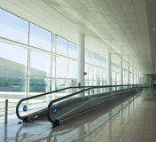 Conveyor belt for people. In a luminous terminal of an airport Stock Image