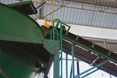 Conveyor belt in plant. drum mold in factory. Conveyor belt for loading fertilizer. drum mold in plant factory stock photography