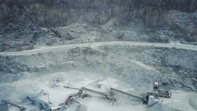 Conveyor belt in stone quarry. Working crusher and conveyor belt in a stone quarry. Aero survey stock footage