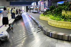 Conveyor belt with suitcases in airport Stock Photos