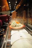 Conveyor belt sushi Stock Images
