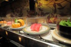 Conveyor belt sushi. Plate of sushi in conveyor belt sushi restaurant royalty free stock photo