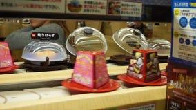 Conveyor Belt in Sushi Restaurant in Japan stock video