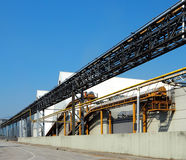 Conveyor belts, buildings and pipes Royalty Free Stock Image