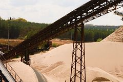 Conveyor belts and sand heaps. Construction industry. Sand quarry. Horizontal  photo. Royalty Free Stock Photography