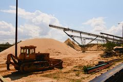 Conveyor belts and sand heaps. Construction industry. Sand quarry. Horizontal  photo. Stock Photos