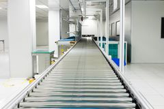 The conveyor chain, and conveyor belt on production line set up in clean room area.  royalty free stock photography