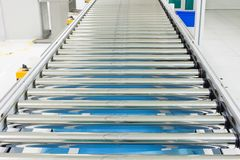 The conveyor chain, and conveyor belt on production line set up in clean room area Royalty Free Stock Photo