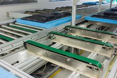 The conveyor chain, and conveyor belt on production line set up in clean room area Stock Photography