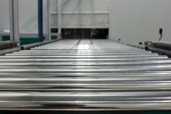 The conveyor chain, and conveyor belt on production line set up in clean room area Stock Image