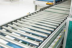 The conveyor chain, and conveyor belt on production line set up in clean room area Royalty Free Stock Photos