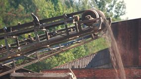 The conveyor conveying the gravel on a sunny day. Conveyor belt at a gravel quarry stock video footage