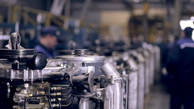 Conveyor with engines. Worker assembling motors, engines. view at factory workshop stock video