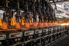 The production of glass bottles factory stock image