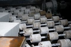 Conveyor on the grinding machine. Rollers on the rolling mill. Conveyor on the grinding machine. Rollers royalty free stock image
