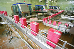 Conveyor line. Working conveyor line on manufacture drinks royalty free stock images