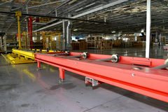 The conveyor line in assembly shop of automobile plant. Interior Stock Photography