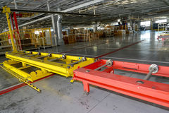 The conveyor line in assembly shop of automobile plant. Russia Stock Image