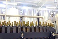 Conveyor line for bottling wine in bottles stock images