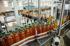 Free Conveyor Line With Plastic Bottles Of Juice At Modern Factory Equipment. Beverage Manufacturing Plant Interior Inside Stock Photos - 157703313