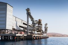 Conveyor and loader for bulk cargo in port. Conveyor and loader for bulk cargo in new Aqaba port stock photography