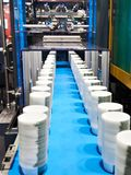 Conveyor machine of plastic containers for food. Conveyor machine for the production of plastic containers for food products royalty free stock photos