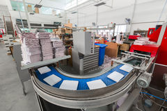 The conveyor with magazines. Printing factory. A stream of journal production. stock image
