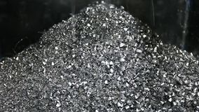 Conveyor moving steel scrap and machining chips from coolant tank to the bin stock video footage