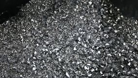 Conveyor moving steel scrap and machining chips from coolant tank to the bin stock footage
