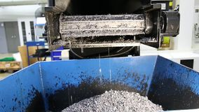 Conveyor moving steel scrap and machining chips from coolant tank to the bin stock video