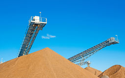 Conveyor open workings. Conveyors and gravel heaps at an industrial Plant for mining of basic materials Stock Photo