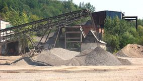 Conveyor and pile of gravel at industrial plant. Gravel pit working site with conveyor belt. Mine industry quarry stock video