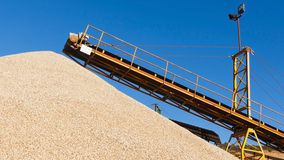 Conveyor with a Pile of Gravel Stock Photo
